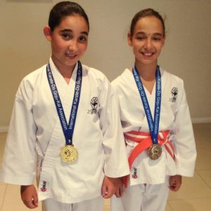 Two young girls started as having competed in Development Tournament with their medals Beginners Karate Kids Perth, well done